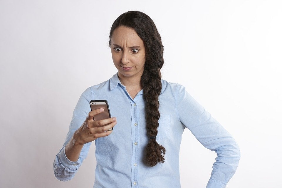 phones on contract with bad credit girl looking at phone