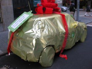 guaranteed phone contracts with free gift car wrapped and tied in red ribbon