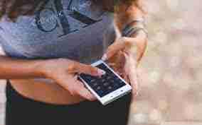 contract phone deals bad credit smartphone in girls hand