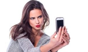 guaranteed mobile phone contracts girl looking at mobile phone in hands