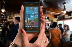 Pay Monthly Phones Bad Credit pay monthly phones people bad credit woman at bar with microsoft nokia lumia